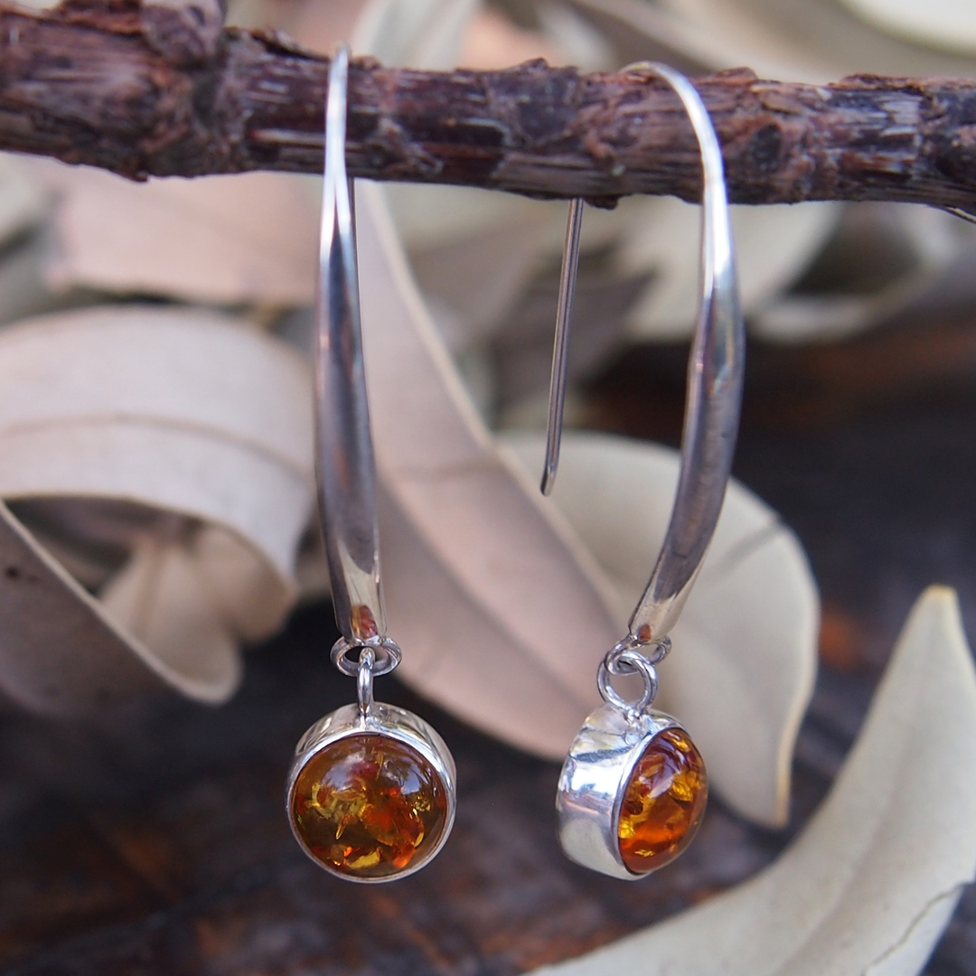 Silver amber earrings on long stems image 0