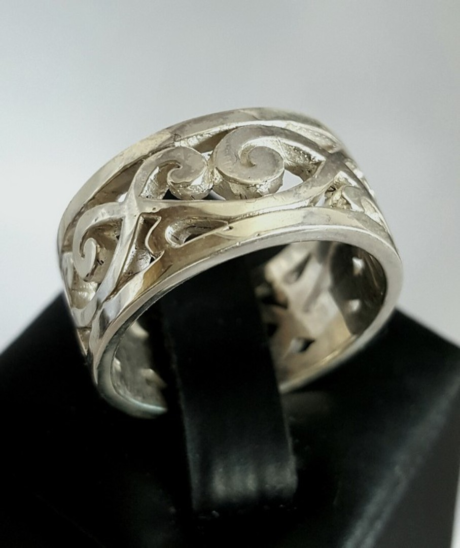 Sterling silver wide band with carved koru designs image 0