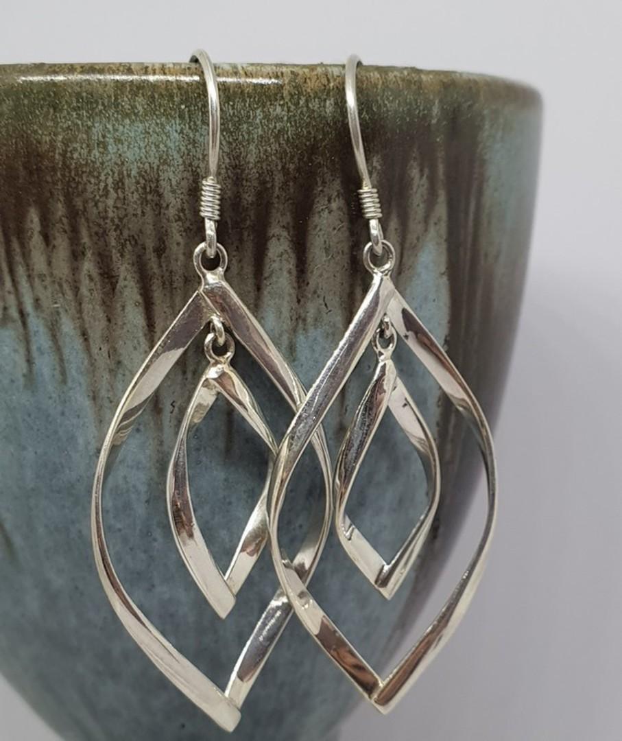 Silver twisted hoop earrings image 0