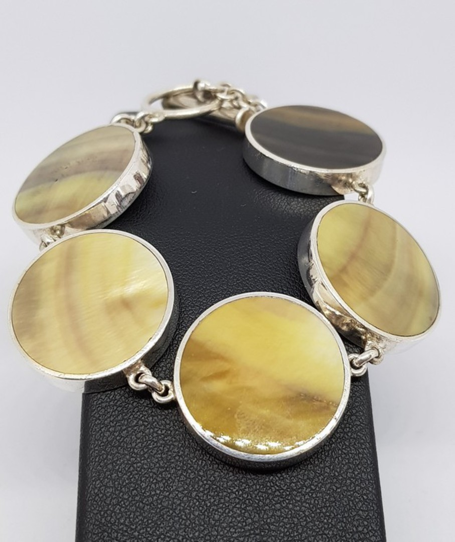 Gold toned shell and silver bracelet image 1