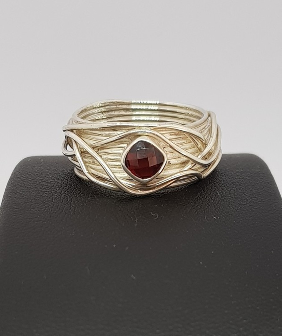 Wide silver band with sparkling garnet set in the top image 3