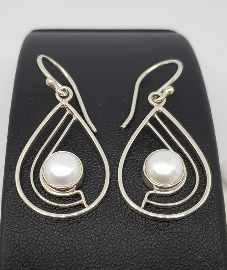 Teardrop white pearl earrings with open silver frame image 1