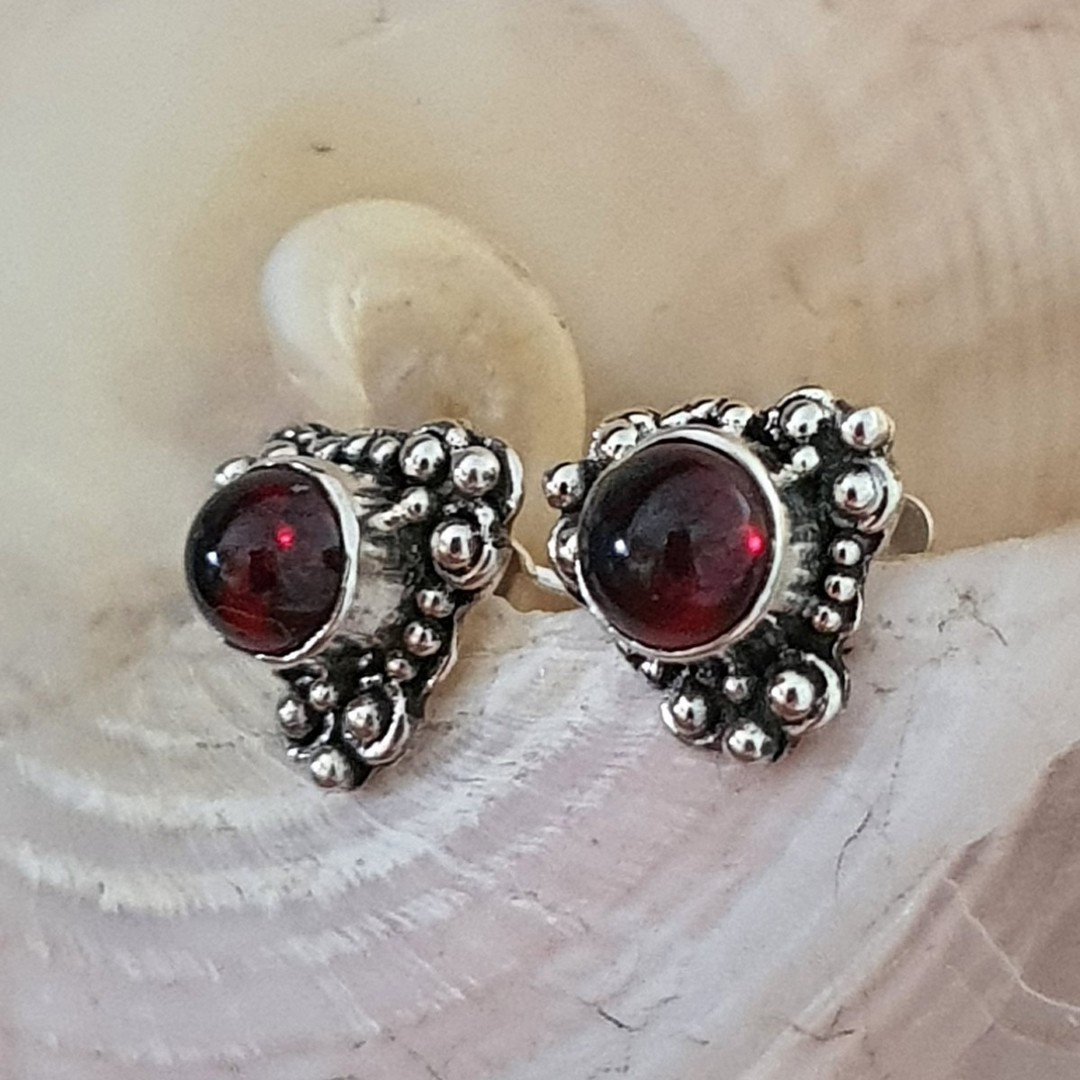 Silver stud earrings with natural garnet image 0