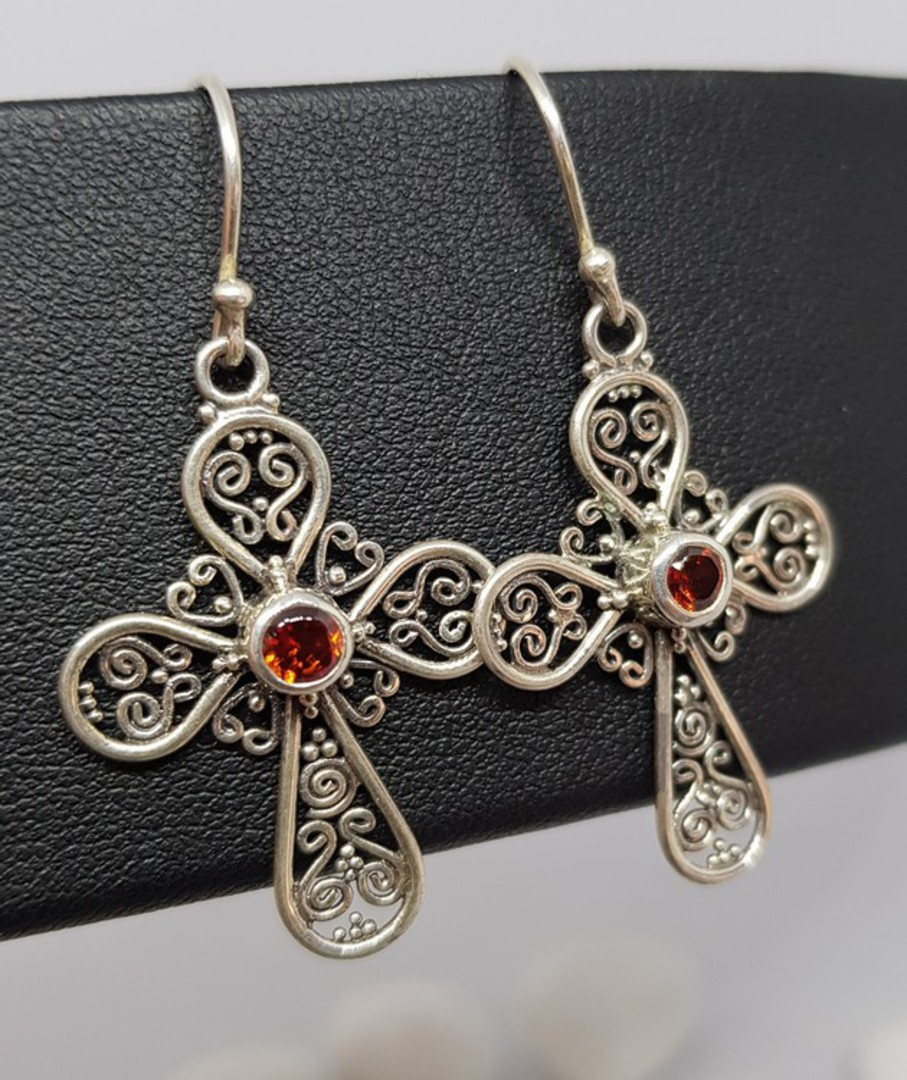 Silver filigree cross earrings with garnet image 0