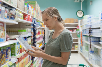 young-caucasian-woman-is-watching-into-product-composition-picture-id646120786-57-943