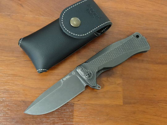 LionSteel Integral Flipper Black Sliepner Drop Point Blade, Titanium Handles - SR11 BB
