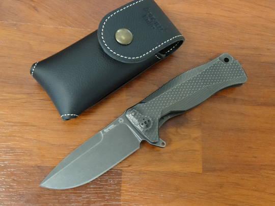 LionSteel Integral Flipper Black Sliepner Drop Point Blade, Titanium Handles - SR11 BB