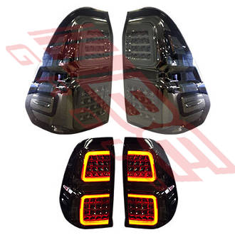 REAR LAMP SET - L&R - SMOKEY - TO SUIT TOYOTA HILUX 2015-