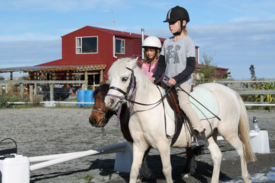 Pony-Lessons-2-children-in-arena