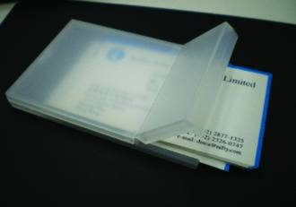 Portable business card holder with snap shut lid