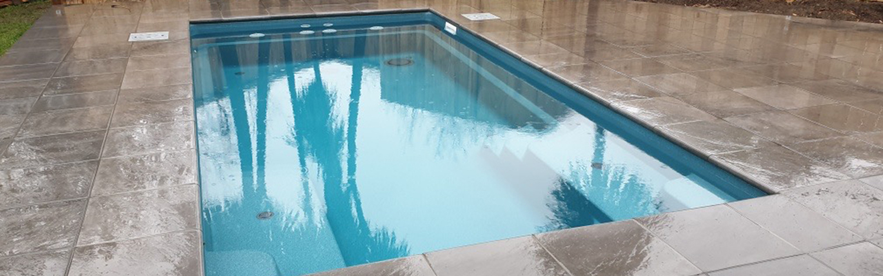 Fibreglass X-Trainer swimming pool installation by Aquanort. Compass Pools dealer.