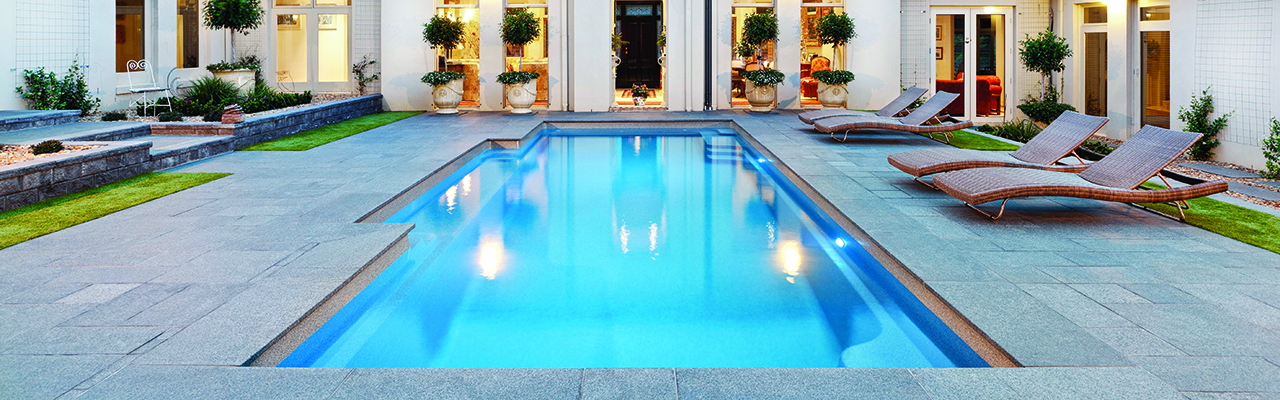 Stunning vogue shape swimming pool. Compass Pools.