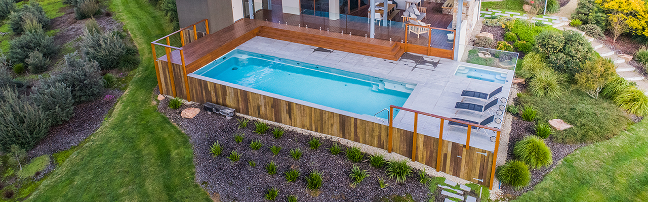 Maxirib above ground swimming pool by Compass Pools