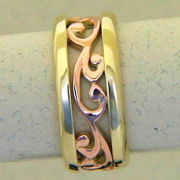 R251 Rose and yellow gold carved koru band
