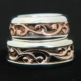 R251 Rose Gold and Silver carved koru band two ring set