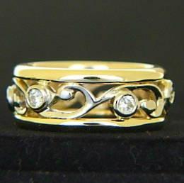 R251 6x Diamonds set  around a carved koru design wedding ring