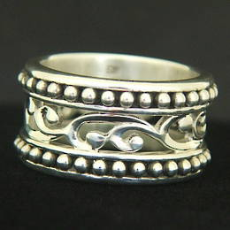 R263 Silver carved band, koru with beaded outer bands