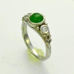 Custom # 205 example, Pounamu NZ Greenstone with diamonds set in white gold .