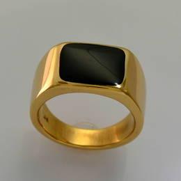 R341. Pounamu, NZ Greenstone  set  in a heavy gold signet type ring.