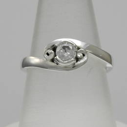 R362 Single Diamond crossover style koru engagement ring in