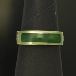 Ladies ring , style R286L  set with Pounamu, NZ Greenstone in a Stg.Silver band.