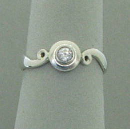 R 320 Koru and a single Diamond set in White Gold.