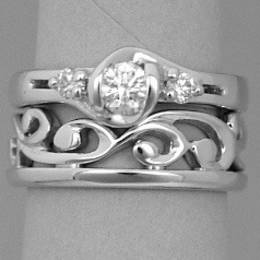 R251F Fitted carved koru wedding band in White Gold