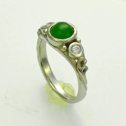 Custom # 205 example, Pounamu NZ Greenstone with diamonds set in white gold .