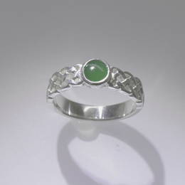 The Celtic Kiwi, style R368 Pounamu NZ  Greenstone on a plaited band .