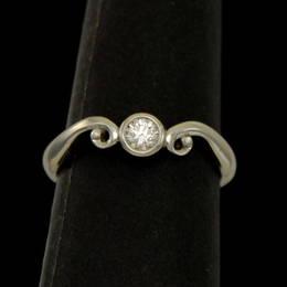 R319 koru design with a single bezel set Diamond