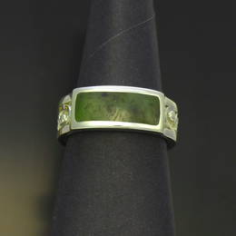 Ring with carved koru design, Pounamu, NZ Greenstone and Stg.Silver.