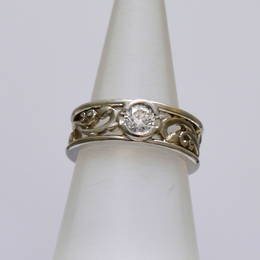 R279 Diamond Koru Engagement ring set in White Gold with a fine carved koru centre