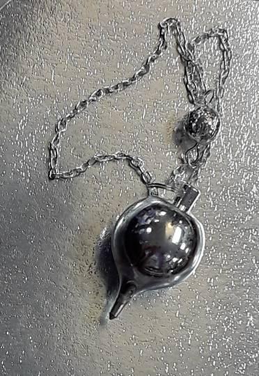 Round Silver Metal Pendulum