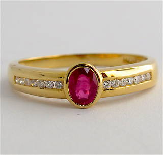 18ct yellow gold natural ruby and diamond set ring