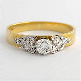 Vintage 18ct yellow and white gold diamond solitaire with fancy design