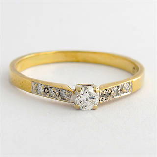 18ct yellow gold & platinum diamond solitaire ring
