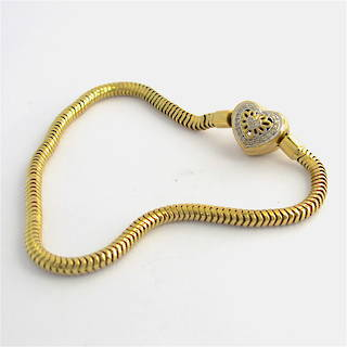 10ct yellow and white gold Michael Hill diamond set charm bracelet