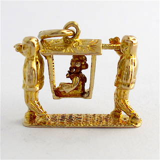 9ct yellow gold Chinese sedan chair with woman being carried charm
