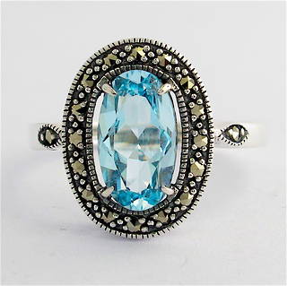 Sterling silver blue topaz and marcasite dress ring