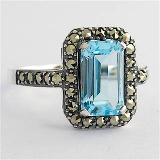 Sterling silver emerald cut blue topaz and marcasite ring
