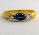 18ct yellow and white gold sapphire and diamond rub over style ring