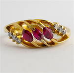 18ct yellow gold natural ruby and diamond dress ring