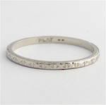 Platinum engraved wedding band