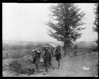 Image of soldiers carrying the wounded