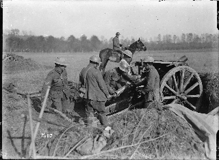 Soldiers loading a howitzer