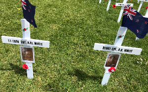 Crosses decorated with photos and flags