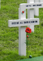 White cross with poppy