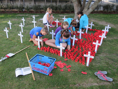 Students laying a field of remembrance.