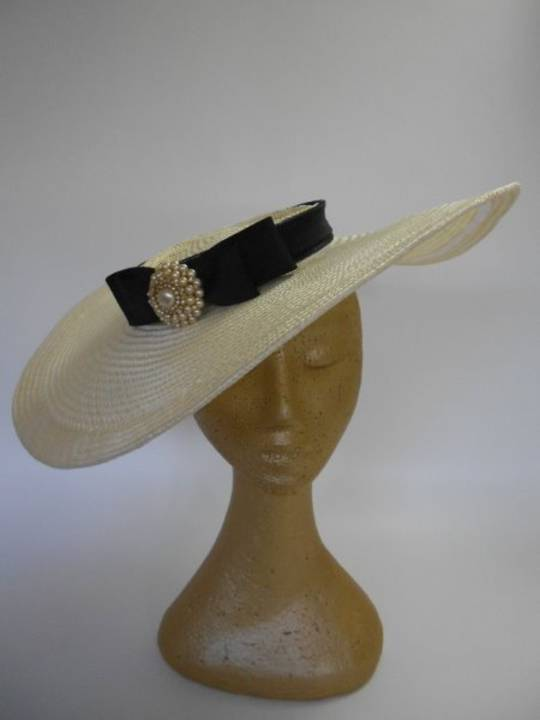 Creme straw with black band and pearl feature $360