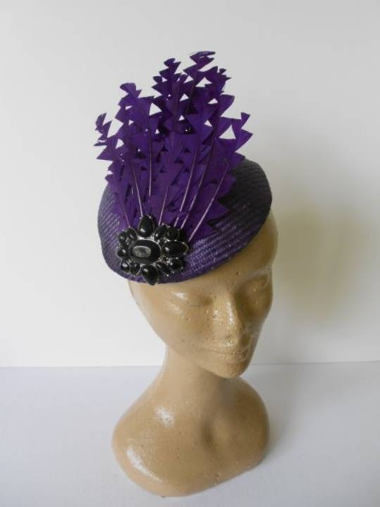 Purple sculptured feathers $180